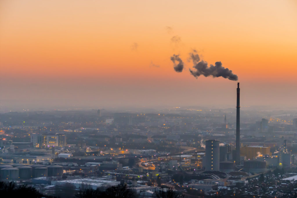 smoking chimneys in the industrial zone in linz, austria, upper austria